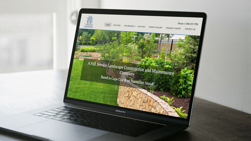 Photo of Blue Claw Landscaping Website on a Laptop