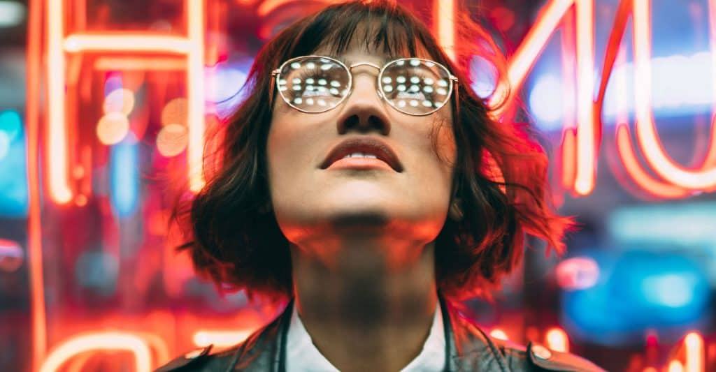 Woman in glasses looking at ads