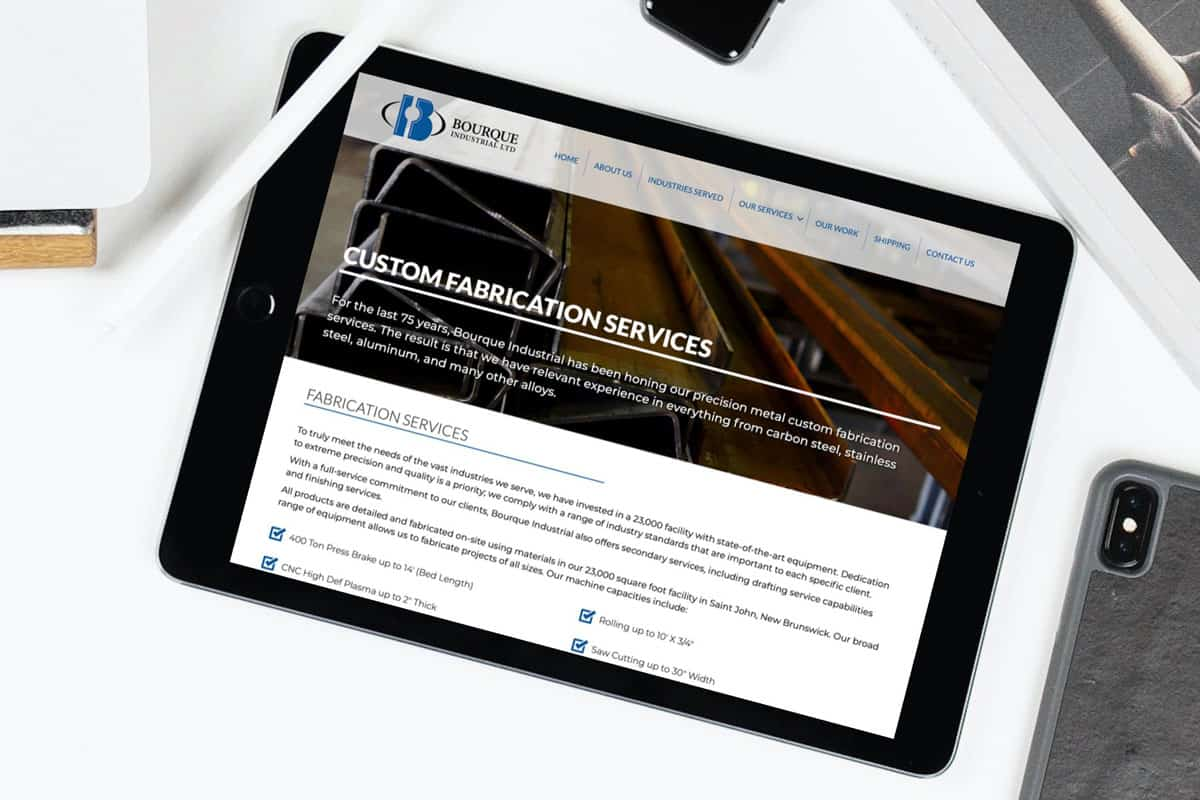 Bourque Industrial Ltd Website By The Pridham Group Displayed On An iPad