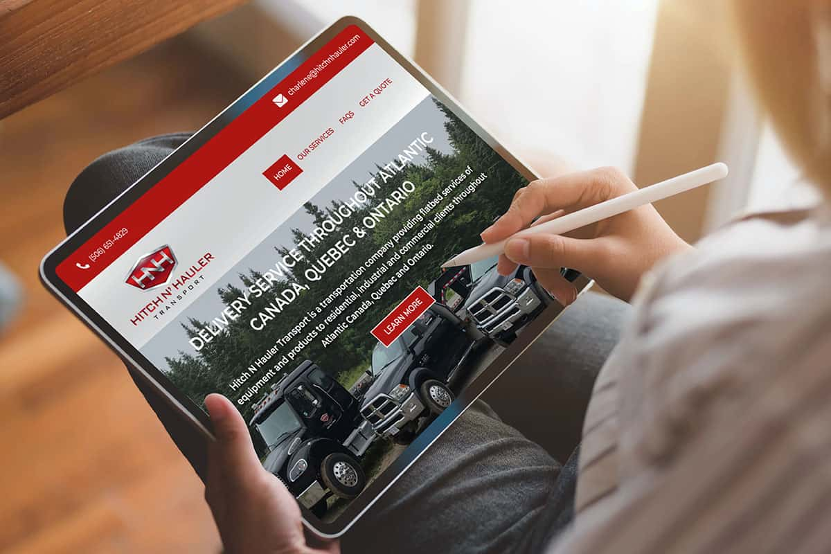 Hitch N' Hauler Transport website design by The Pridham Group displayed on an iPad
