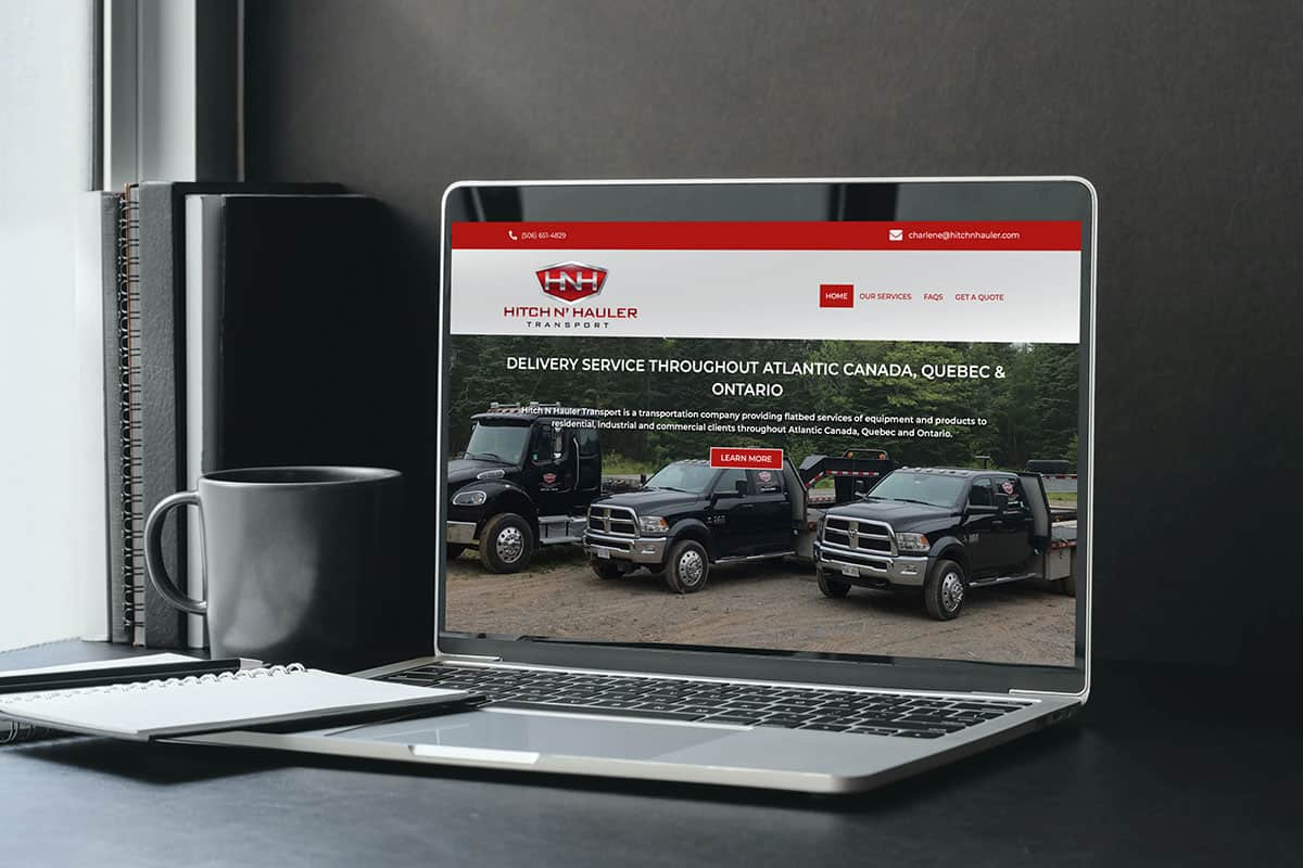 Hitch N' Hauler Transport website design by The Pridham Group displayed on a Macbook Pro laptop