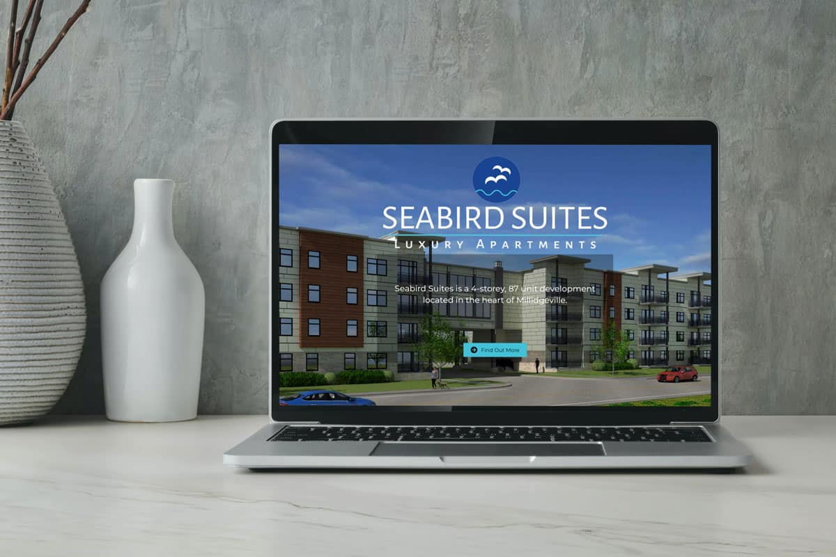 SeaBird Suites website design by The Pridham Group displayed on a Macbook Pro